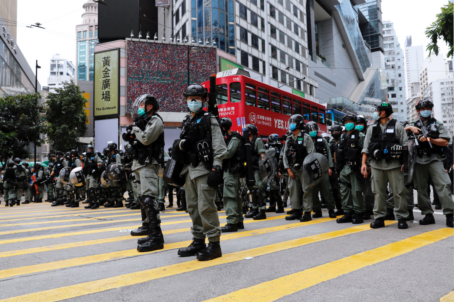 Riot police stand guard during a march against Beijing's plans to impose national security legislation in Hong Kong