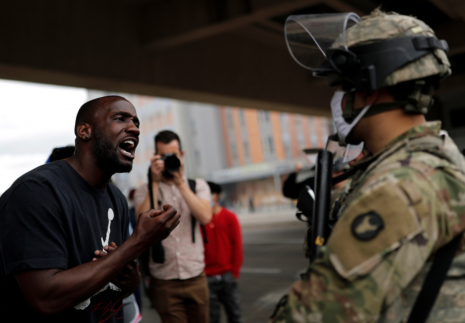 A man confronts a National Guard member guarding the area in the aftermath of a protest against the death in Minneapolis police custody of African-American man George Floyd